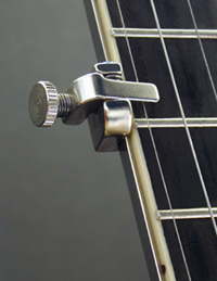 THE SHUBB FIFTH STRING CAPO FOR BANJO.