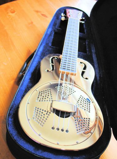 THE CLIFFORD ESSEX RESONATOR UKULELE WITH CASE.
